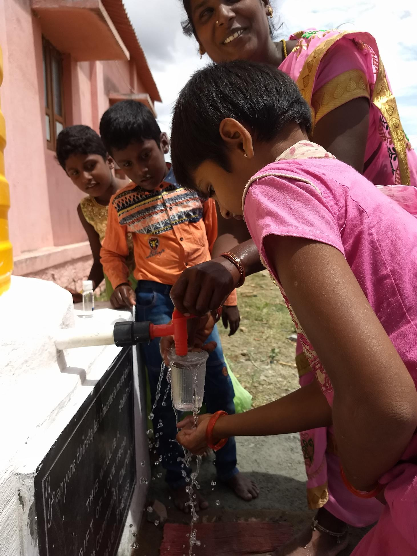 Elated family with water for children